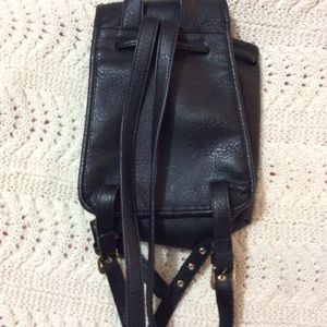 Free people leather tassel backpack brand new .